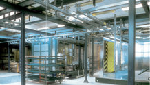 Overhead monorail system in a paint finishing system with shifting bridge