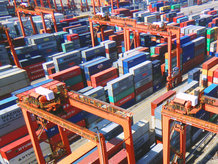 RMG Container Cranes are moving containers in a container block at a container terminal